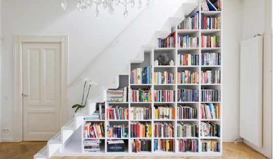 bookshelve under stairs