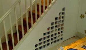wine racks under stairs